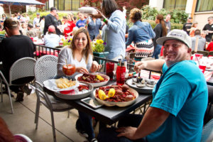 A local couple enjoys the all-you-can-eat crawfish fest at Dodies' restaurant at The Harbor Rockwall